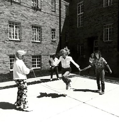 Girls Playing at a Courtyard